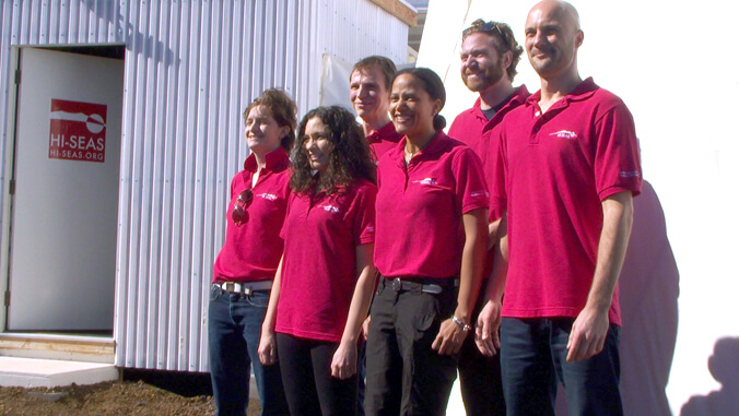 six people wearing red shirts