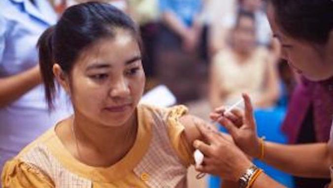 woman getting vaccine shot