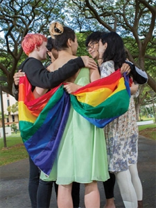 group with a pride flag