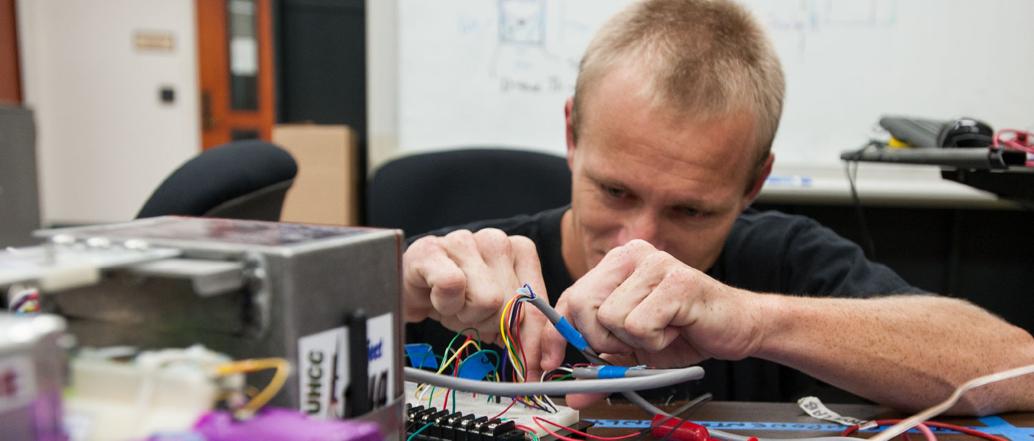 Man working with circuitry