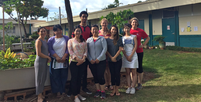 photo of SLS student volunteers and faculty with Wai'alae Elementary School staff