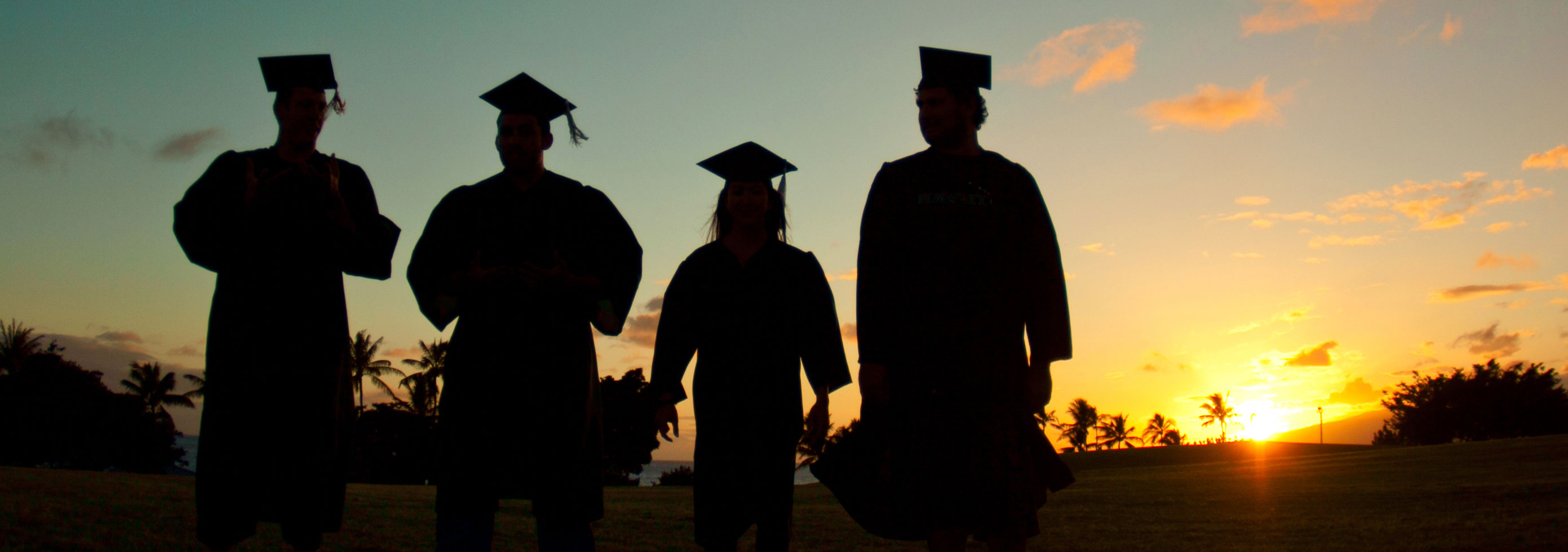 graduates at sunset
