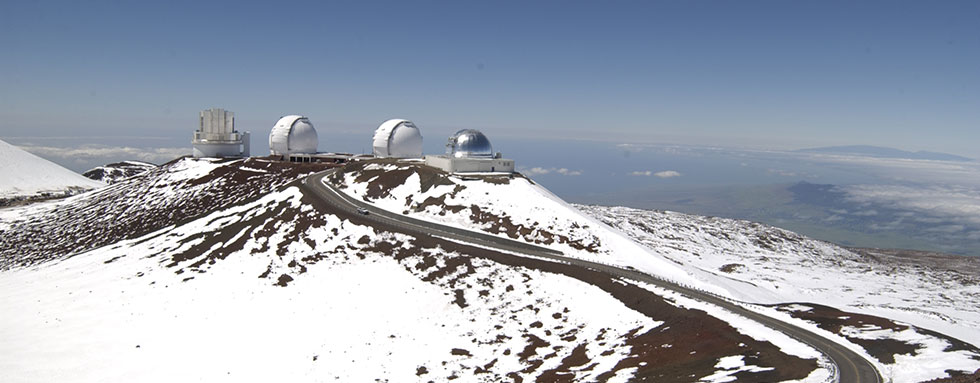 Snow on Maunakea with observatories