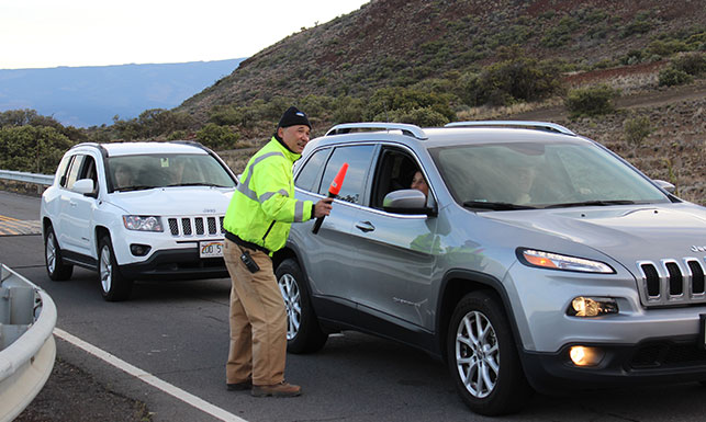 Maunakea Ranger giving advise to visitors in vehicle