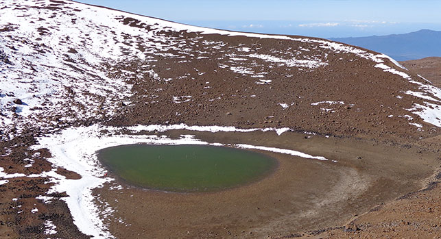 Water from melted snow accumulates into a lake on Maunakea