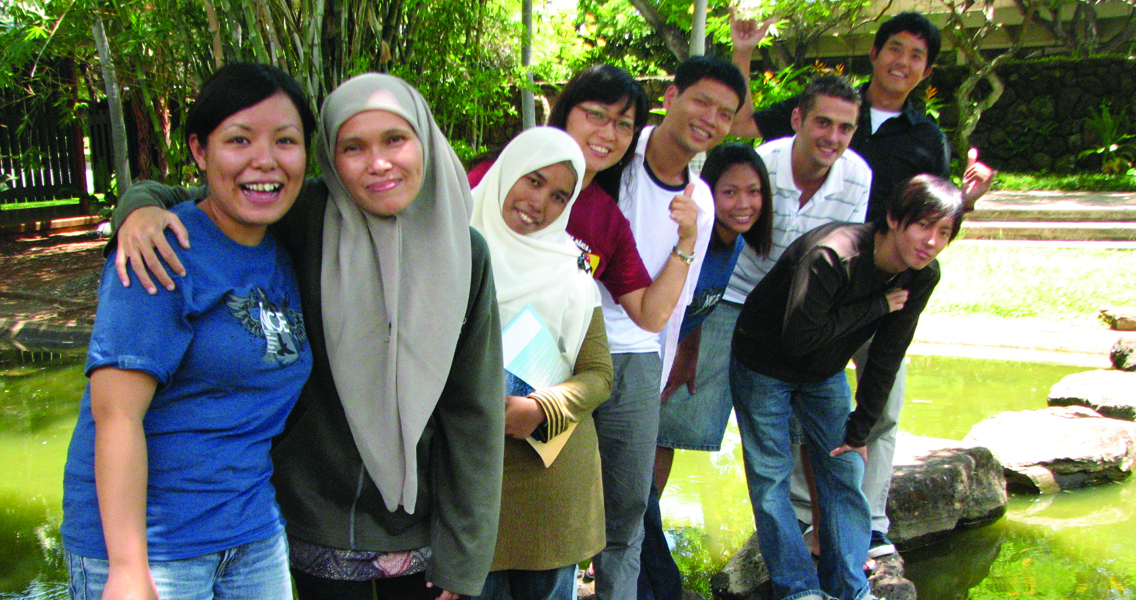 International students waving