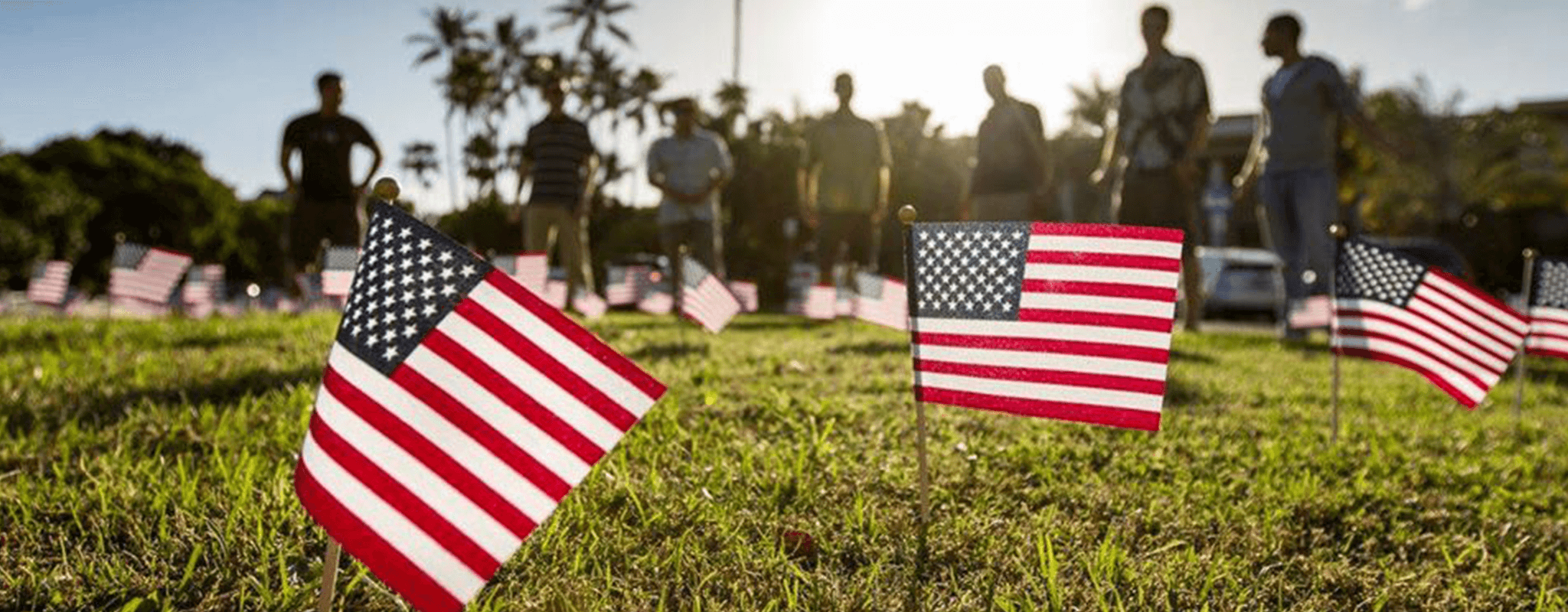 United States of America flags adorn the Varney Circle lawn in front of Hawaii Hall on the Manoa campus